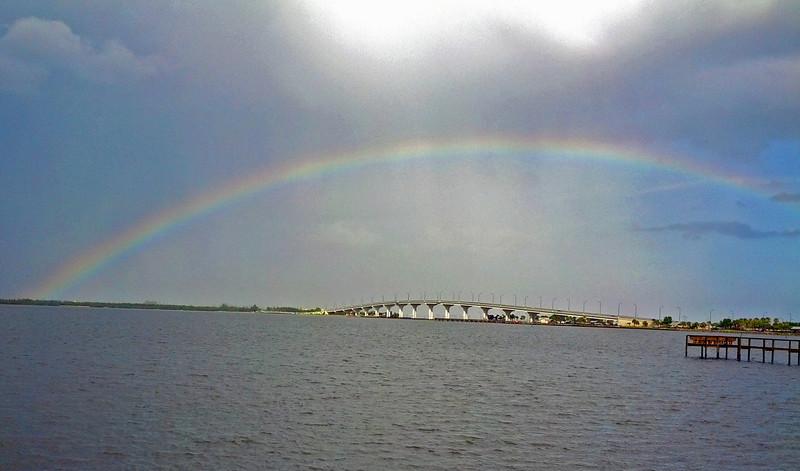 Rainbow over bridge. (Taken with phone)