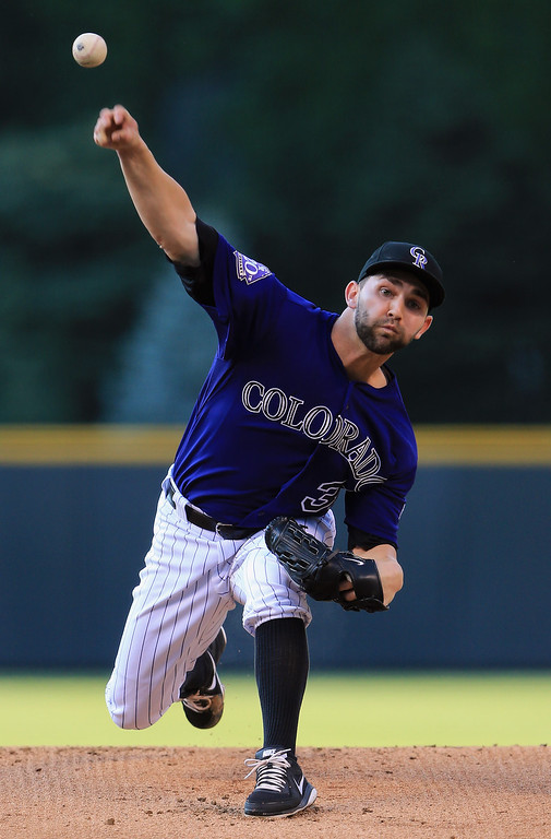 . DENVER, CO - JULY 26:  Starting pitcher Tyler Chatwood #32 of the Colorado Rockies delivers against the Milwaukee Brewers at Coors Field on July 26, 2013 in Denver, Colorado.  (Photo by Doug Pensinger/Getty Images)