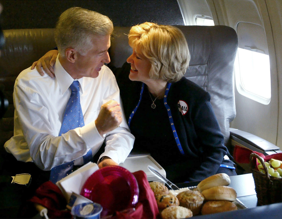 . California Governor Gray Davis pumps his fist as he speaks with his wife Sharon on the campaign plane before departing Burbank Airport for Sacramento, Calif., Monday , Oct. 6, 2003, in the the last full day of campaigning before the recall election. (AP Photo/Kevork Djansezian)