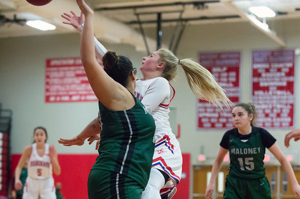 12/20/19 Wesley Bunnell | StaffrrBerlin girls basketball defeated Maloney on Monday night at home 44-20. Carly Grega (15) goes up for a right hand layup.