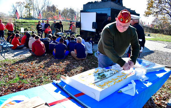 11/2/2019 Mike Orazzi | StaffrJames Morris, commandant of the Hardware City Detachment of the Marine Corps League cuts cake during a Marine Corps 244th birthday celebration at the National Iwo Jima Memorial in New Britain Saturday morning.