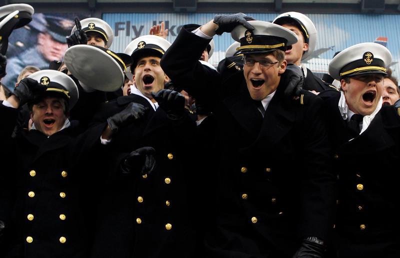 . Navy Midshipmen cheer during the 113th Army Navy football game in Philadelphia Saturday Dec. 8, 2012. (AP Photo/Jacqueline Larma)