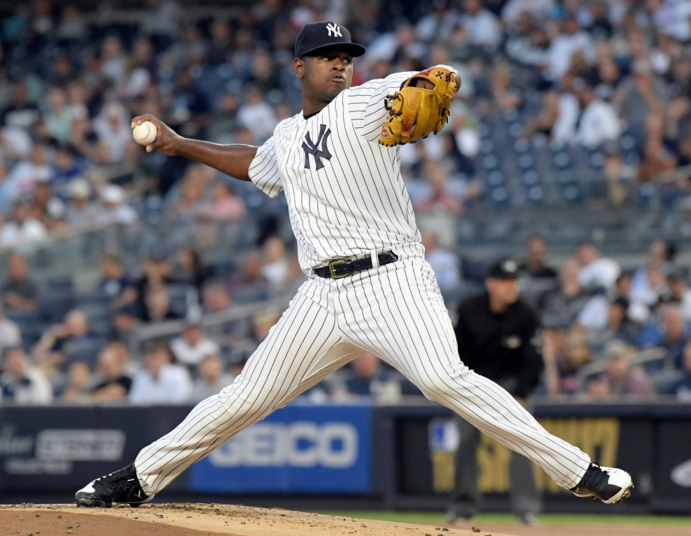 . New York Yankees pitcher Luis Severino delivers the ball to the Cleveland Indians during the first inning of a baseball game, Monday, Aug. 28, 2017, at Yankee Stadium in New York. (AP Photo/Bill Kostroun)