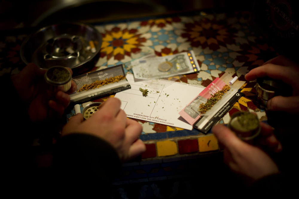 Description of . Cannabis joints are being rolled, costing 10 Euros per gram, in a coffee shop on November 1, 2012 in the center of Amsterdam, Netherlands. Coffee shops in the Dutch captial will remain open to tourists after its mayor, Eberhard van der Laan, decided that tourists will not be banned from the 220 coffee shops in Amsterdam where marijuana and hashish are openly sold and consumed. The decision came after the new government of the Netherlands stated that it would be up to local authorities to decide whether or not to impose a ban on cannabis.  (Photo by Jasper Juinen/Getty Images)