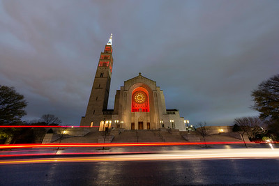 Basilica lit up in red