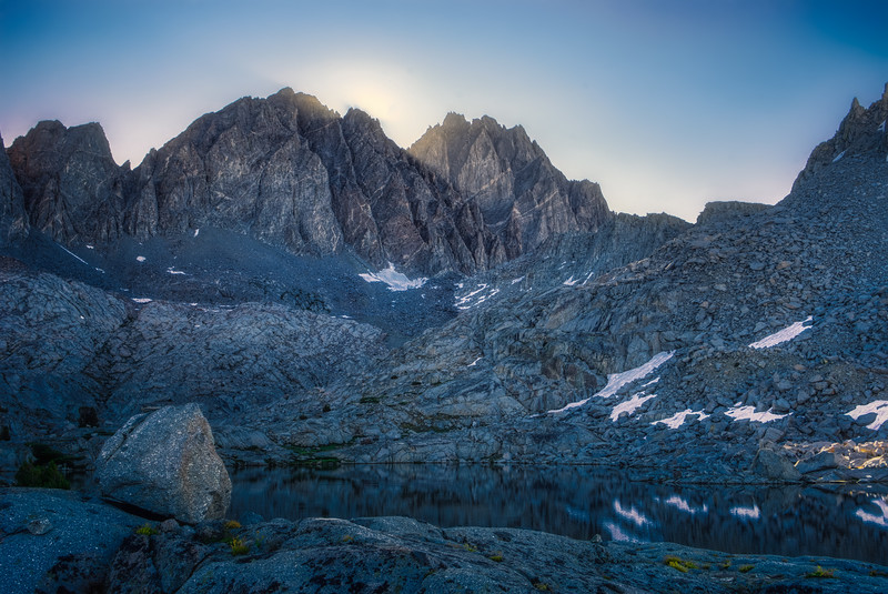 The sun rising between Thunderbolt Peak and the North Palisade