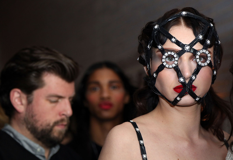 . A model prepares backstage at the Chromat fashion show during MADE Fashion Week Fall 2014 at The Standard Hotel on February 6, 2014 in New York City.  (Photo by Monica Schipper/Getty Images)