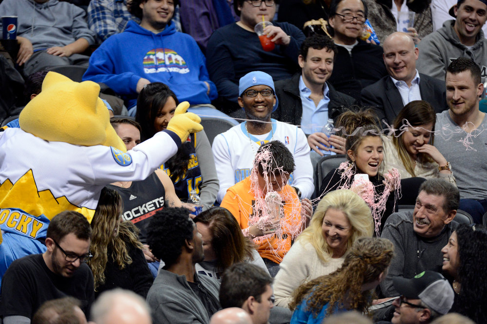 . DENVER, CO. - JANUARY 30: Denver Nuggets mascot Rocky sprays silly string on fans during the third quarter January 30, 2013 at Pepsi Center. The Denver Nuggets take on the Houston Rockets in NBA action. (Photo By John Leyba/The Denver Post)