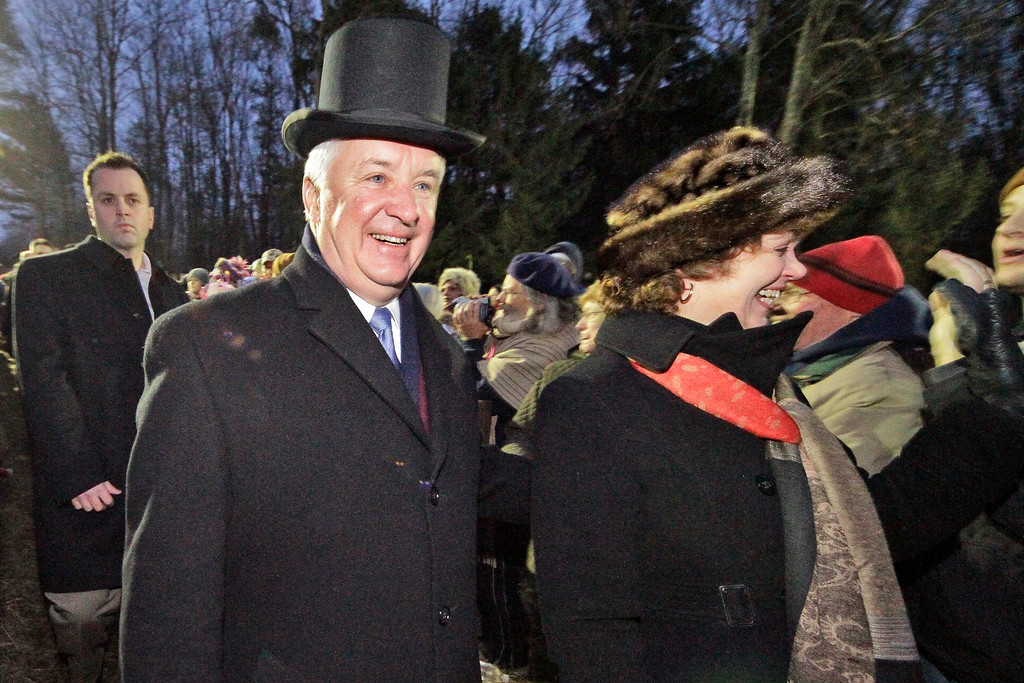 . Pennsylvania Governor Tom Corbett, left, and his wife Susan arrive on Gobbler\'s Knob during the 126th celebration of Groundhog Day on Thursday, Feb. 2, 2012. Weather prognosticating groundhog Punxsutawney Phil saw his shadow, forecasting six more weeks of winter weather. (AP Photo/Gene J. Puskar)