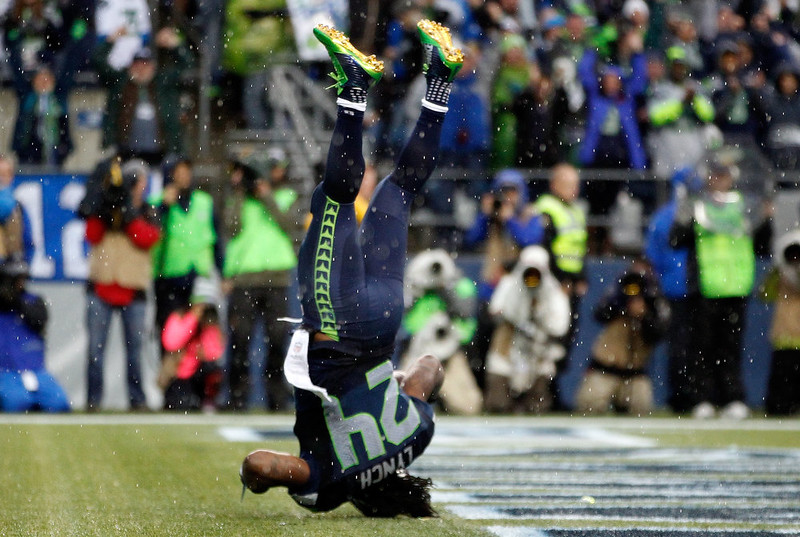 . Running back Marshawn Lynch #24 of the Seattle Seahawks dives into the end zone for a touchdown during the fourth quarter of the game against the New York Giants at CenturyLink Field on November 9, 2014 in Seattle, Washington.  (Photo by Otto Greule Jr/Getty Images)