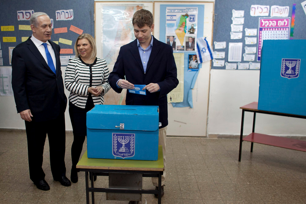 Description of . Yair Netanyahu, the son of†Israeli Prime Minister Benjamin Netanyahu, left, casts his ballot†together with his parents at a polling station in Jerusalem, Tuesday, Jan. 22, 2013.†Israelis headed to polling stations Tuesday to cast votes in a parliamentary election expected to return Netanyahu to office despite years of stalled peacemaking with the Palestinians and mounting economic troubles. (AP Photo/Uriel Sinai, Pool)