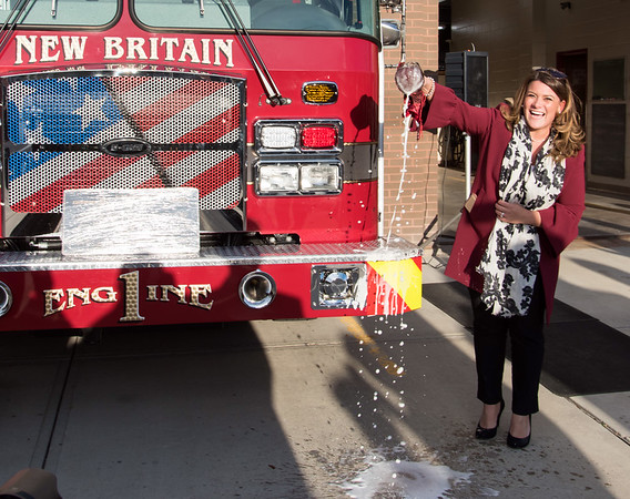 11/14/18 Wesley Bunnell | Staff The New Britain Fire Department unveiled three new fire trucks on Wednesday afternoon during a ceremony at their Beaver St headquarters. Mayor Erin Stewart dedicated Engine 1 by smashing a bottle of champagne across the bumper.