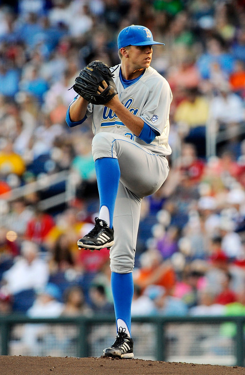 . UCLA starting pitcher Nick Vander Tuig winds up to deliver against North Carolina State in the first inning of an NCAA College World Series baseball game in Omaha, Neb., Tuesday, June 18, 2013. (AP Photo/Eric Francis)
