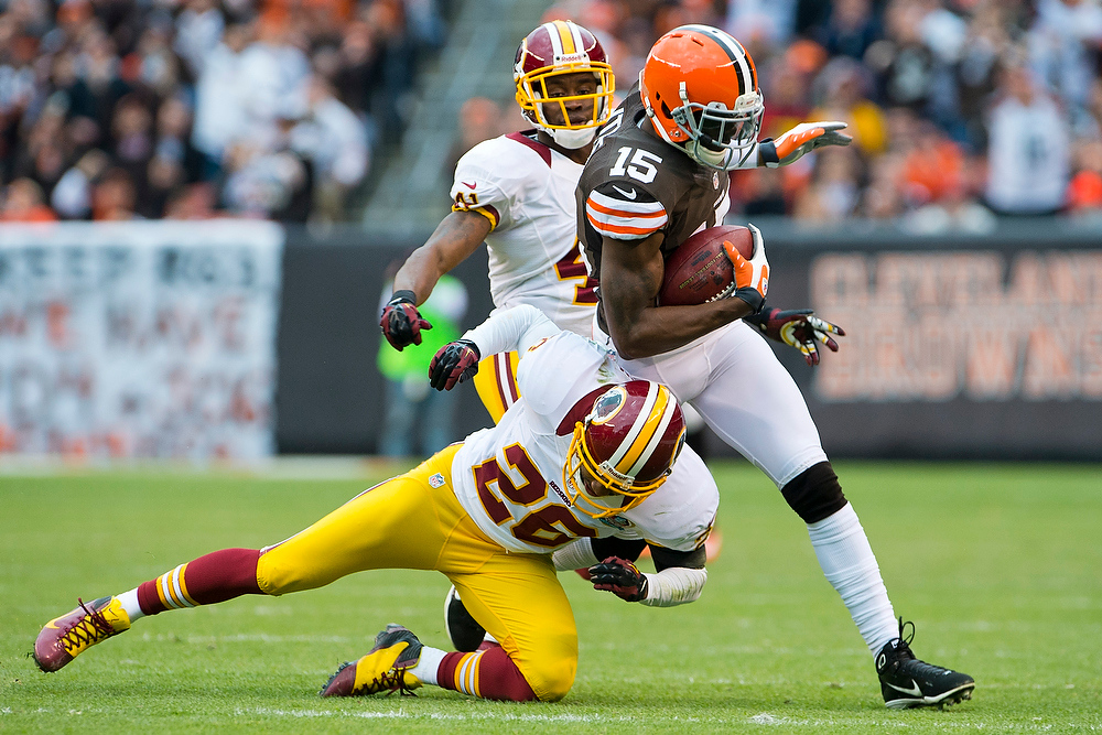 . Wide receiver Greg Little #15 of the Cleveland Browns is tackled by cornerback Josh Wilson #26 of the Washington Redskins during the first half at Cleveland Browns Stadium on December 16, 2012 in Cleveland, Ohio. (Photo by Jason Miller/Getty Images)