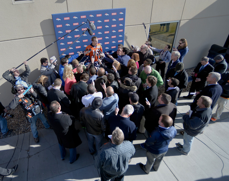 . Denver Broncos quarterback Peyton Manning (18) talks with the media after practice January 16, 2014 at Dove Valley. The Denver Broncos are preparing for their AFC Championship game against the New England Patriots at Sports Authority Field.  (Photo by John Leyba/The Denver Post)