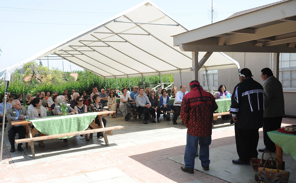 . (John Valenzuela/Staff Photographer) San Bernardino County Third District Supervisor James Ramos, Serrano-Cahuilla Elder Kim Marcus, and Paakuma perform Serrano-Cahuilla songs during the dedication cermony of the renovated Barton School House at The Grove School in Redlands, May 24, 2013.