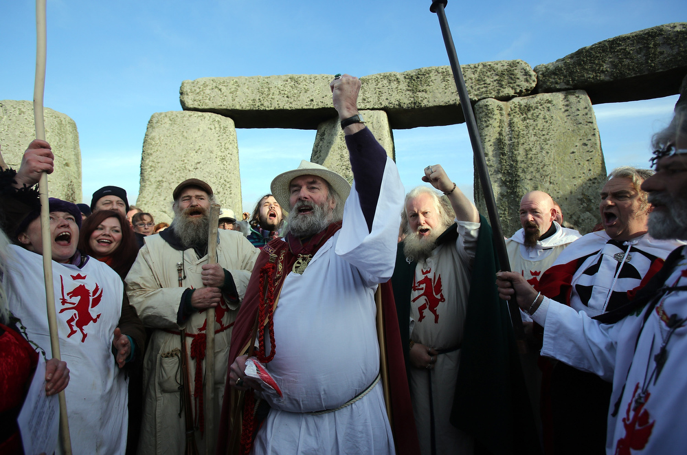Description of . Druids conduct a ceremony following the traditional winter solstice celebrations at Stonehenge to coincide with the supposed Mayan Apocalypse, on December 21, 2012 in Wiltshire, England. Predictions that the world will end today as it marks the end of a 5,125-year-long cycle in the ancient Maya calendar, encouraged a larger than normal crowd to gather at the famous historic stone circle to celebrate the sunrise closest to the Winter Solstice, the shortest day of the year.  (Photo by Matt Cardy/Getty Images)