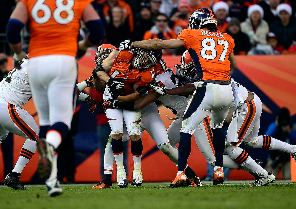 . Denver Broncos wide receiver Brandon Stokley (14) pulls in a ball during the third quarter.  The Denver Broncos vs Cleveland Browns at Sports Authority Field Sunday December 23, 2012. AAron Ontiveroz, The Denver Post