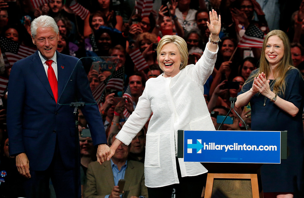 . Former President Bill Clinton, left, stands on stage with his wife, Democratic presidential candidate Hillary Clinton, center, and their daughter, Chelsea Clinton, after Hilary Clinton spoke during a presidential primary election night rally, Tuesday, June 7, 2016, in New York. (AP Photo/Julio Cortez)