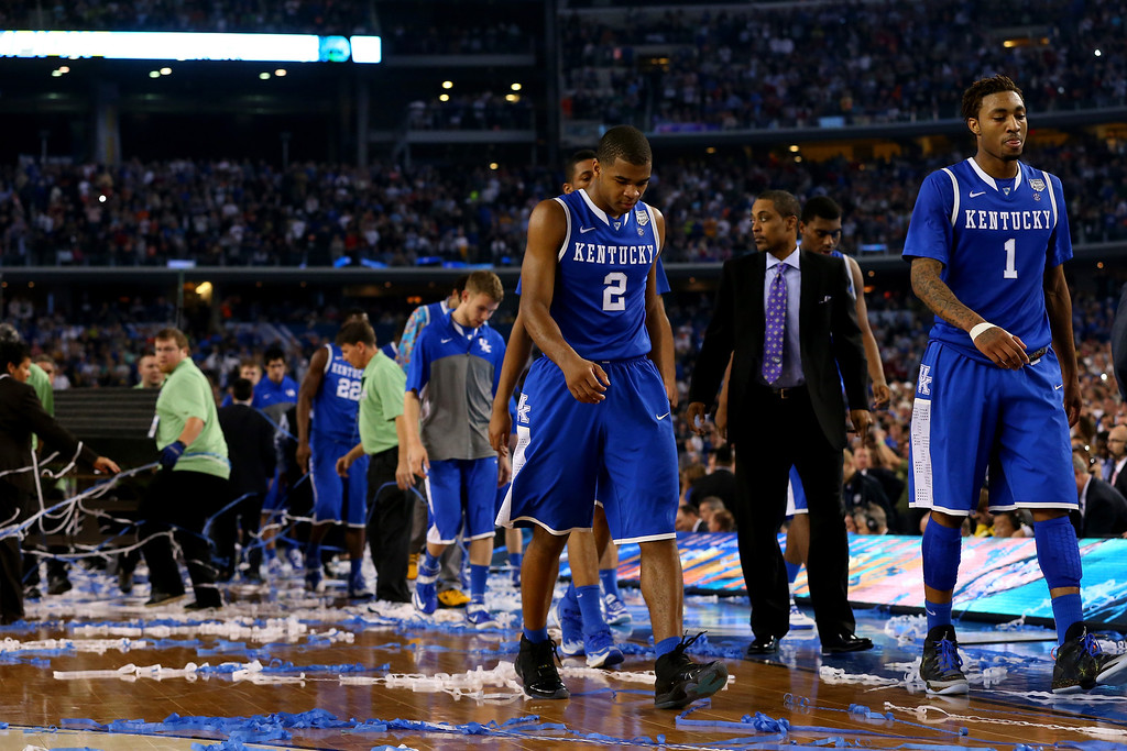 . ARLINGTON, TX - APRIL 07: Aaron Harrison #2 and James Young #1 of the Kentucky Wildcats walk off the court after losing to the Connecticut Huskies 60-54 in the NCAA Men\'s Final Four Championship at AT&T Stadium on April 7, 2014 in Arlington, Texas.  (Photo by Ronald Martinez/Getty Images)
