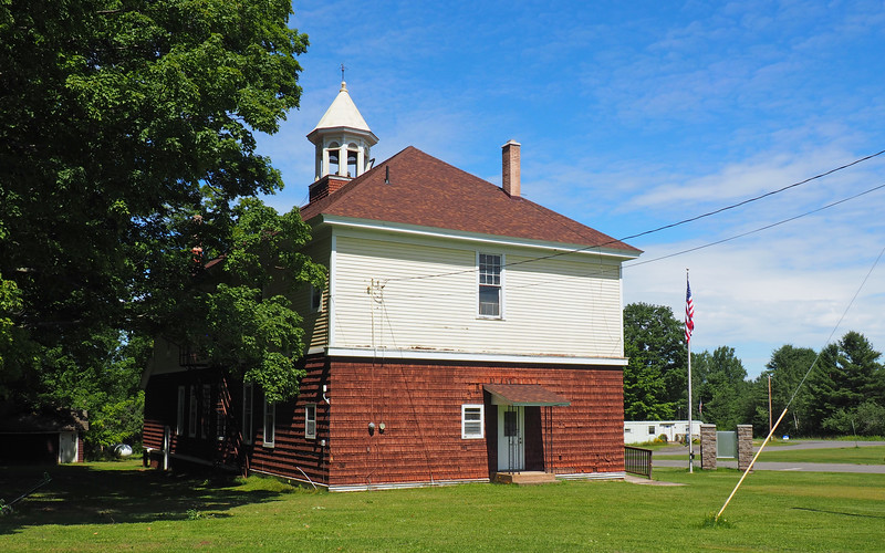 The Skanee Town Hall is the meeting place for Arvon Township. The Skanee post office is in the trailer-building in the background.