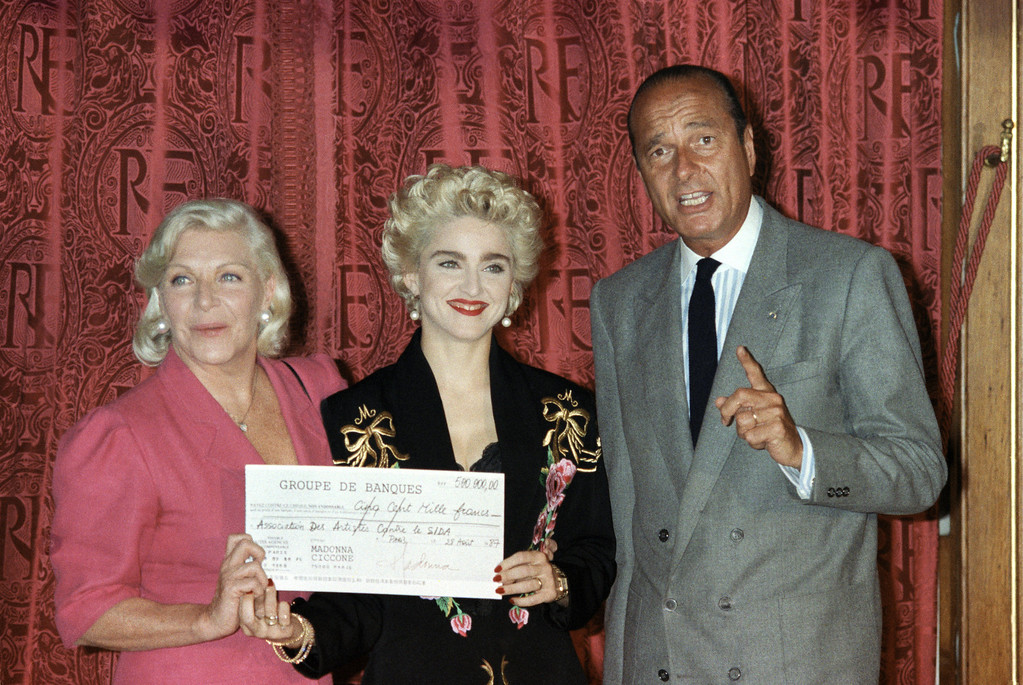 . Rock star Madonna poses with French singer Line Renaud, left, and French Premier Jacques Chirac at Paris City Hall, Aug. 28, 1987 holding a 500,000-franc ($83,000 U.S.) check for the Line Renaud sponsored foundation to help medical research on AIDS. (AP Photo/Pierre Gleizes)
