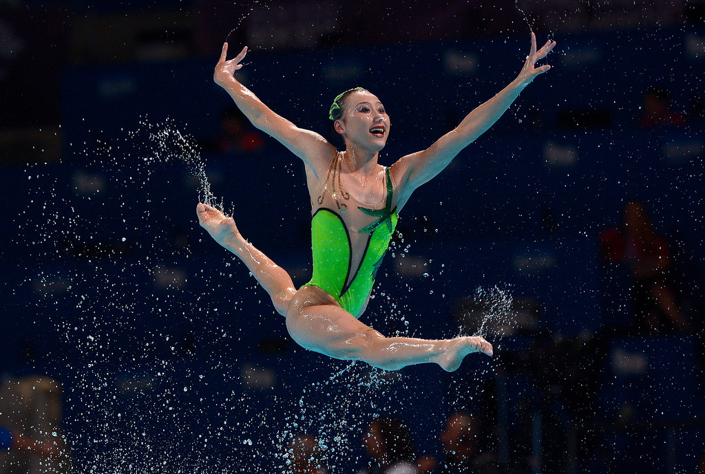 . A swimmer from the North Korea is airborne as her team performs their routine in the synchronised swimming free combined event at the FINA Swimming World Championships in Barcelona, Spain, Sunday, July 21, 2013.(AP Photo/Manu Fernandez)