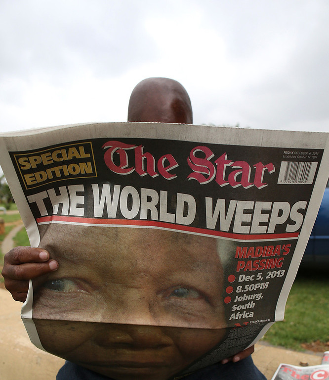 . A man reads, in Soweto on December 6, 2013, a local newspaper, The Star, with the front page dedicated to South African former President Nelson Mandela, following his death in Johannesburg on the eve. Mandela, the revered icon of the anti-apartheid struggle in South Africa and one of the towering political figures of the 20th century, has died aged 95. Mandela, who was elected South Africa\'s first black president after spending nearly three decades in prison, had been receiving treatment for a lung infection at his Johannesburg home since September, after three months in hospital in a critical state. ALEXANDER JOE/AFP/Getty Images