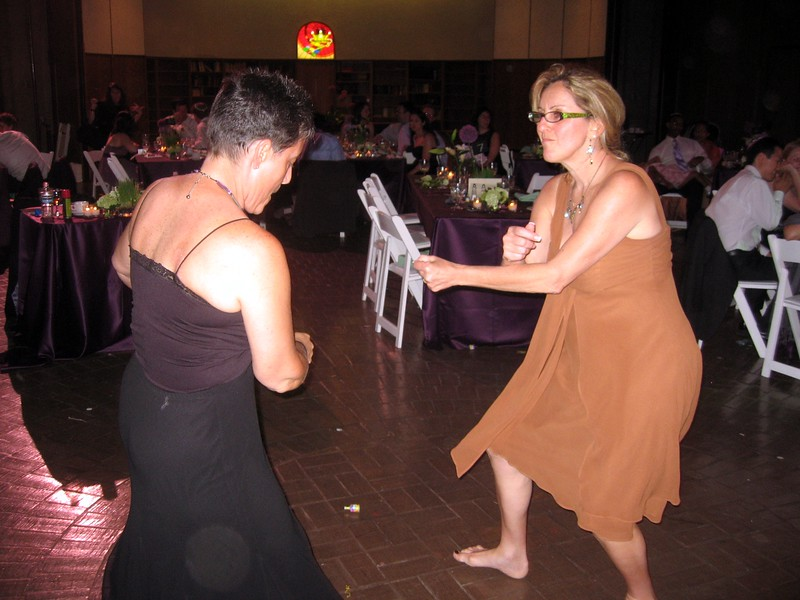 Jamie (aunt of the bride) dances with Janice (friend of the bride)