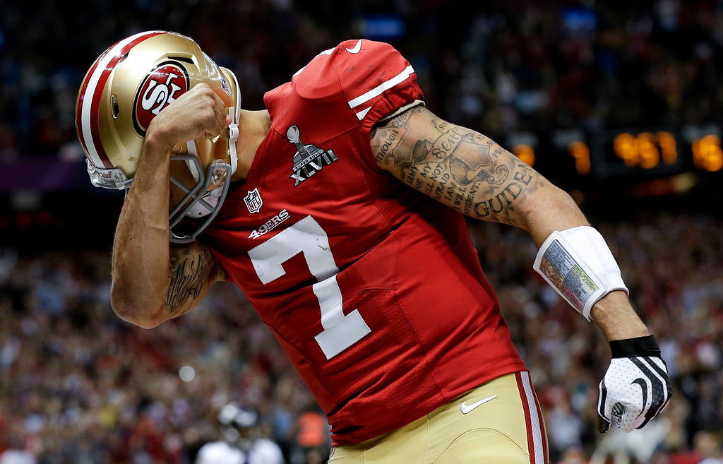 . San Francisco 49ers quarterback Colin Kaepernick celebrates his touchdown against the Baltimore Ravens during the second half of the NFL Super Bowl XLVII football game, Sunday, Feb. 3, 2013, in New Orleans. (AP Photo/Dave Martin)