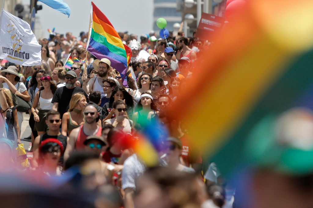 . Israelis and tourists participate in the gay pride parade in Tel Aviv, Israel, Friday, June 8, 2018. The Tel Aviv Municipality said 250,000 people celebrated on Friday. (AP Photo/Sebastian Scheiner)