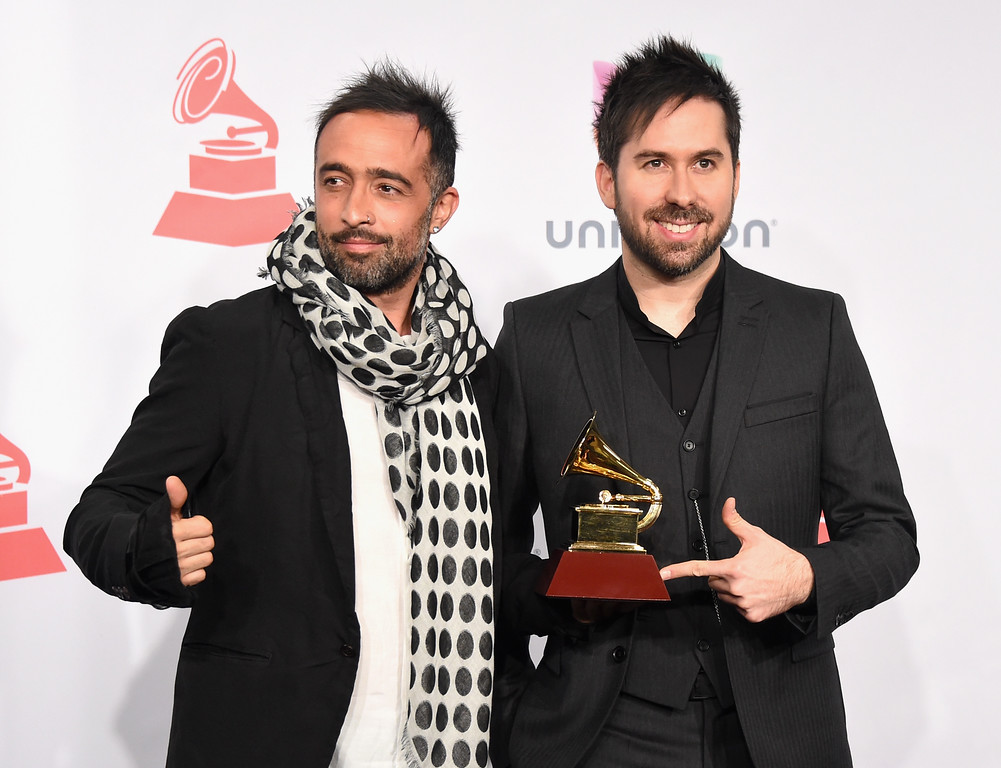 . Recording artists Mario Domm (L) and Pablo Hurtado of music group Camila, winner of the Best Contemporary Pop Vocal Album, attend the 15th Annual Latin GRAMMY Awards at the MGM Grand Garden Arena on November 20, 2014 in Las Vegas, Nevada.  (Photo by Jason Merritt/Getty Images)