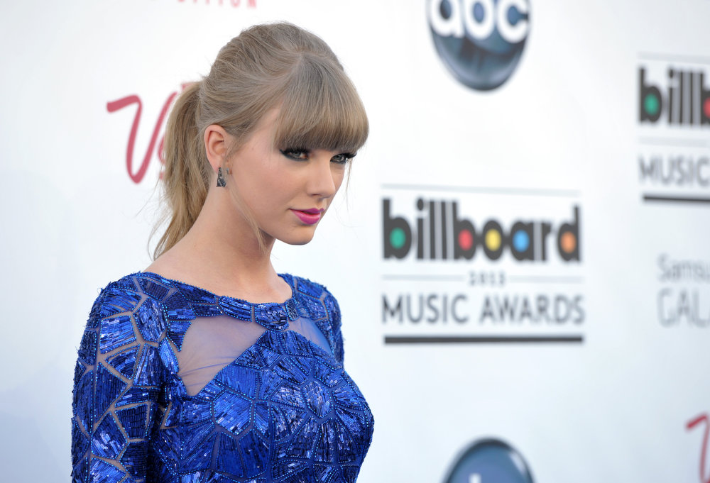 . Taylor Swift arrives at the Billboard Music Awards at the MGM Grand Garden Arena on Sunday, May 19, 2013 in Las Vegas. (Photo by John Shearer/Invision/AP)