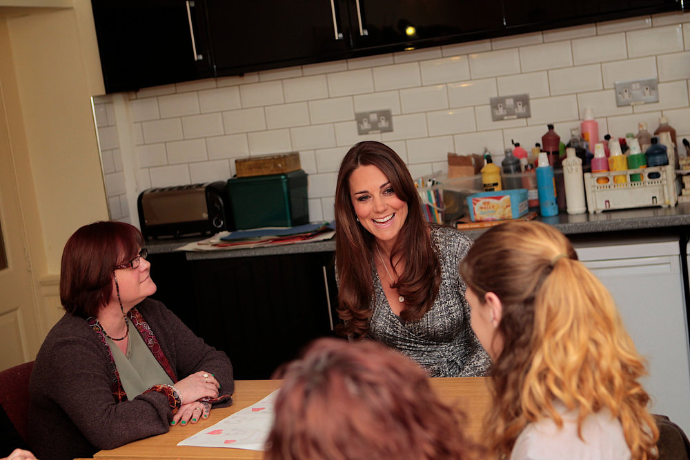 Description of . Britain's Catherine, Duchess of Cambridge (C) speaks with the art therapy group during her official visit to Hope House residential treatment centre, run by Action on Addiction for recovering addicts, London February 19, 2013.  REUTERS/Mary Turner/pool