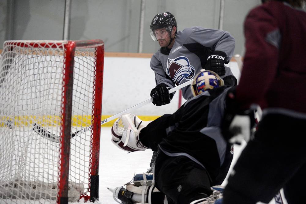 . Colorado Avalanche RW Milan Hejduk (23) takes a shot  during practice Wednesday, January 16, 2013 at Family Sports Center. John Leyba, The Denver Post