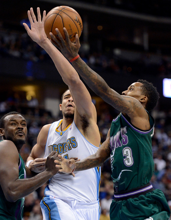 . DENVER, CO. - FEBRUARY 05: JaVale McGee (34) of the Denver Nuggets blocks a shot by Brandon Jennings (3) of the Milwaukee Bucks during the third quarter February 05, 2013 at Pepsi Center. The Denver Nuggets defeated the Milwaukee Bucks 112-104 in NBA action. (Photo By John Leyba/The Denver Post)