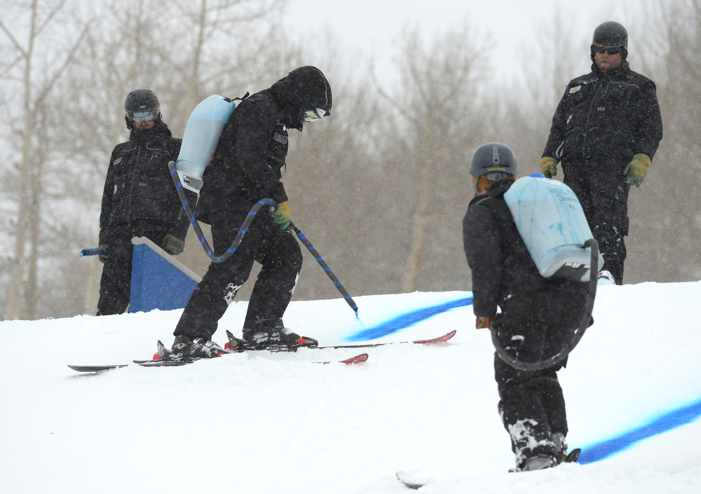 . Park crews take care of the course of the men\'s slope style final of the Burton U.S. Open. Vail, Colorado. March 7. 2014. (Photo by Hyoung Chang/The Denver Post)
