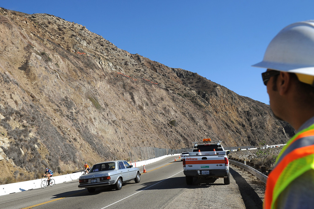 . Traffic is allowed to go through a work is halted on the hillside along PCH south of Pt. Mugu during a scaling project, Monday, November 25, 2013, to dislodge potentially dangerous rocks on a hillside that was burnt during the Springs Fire last May. A steel mesh netting will be placed over the hillside in a couple weeks. (Photo by Michael Owen Baker/L.A. Daily News)