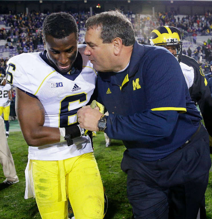 . Michigan head coach head coach Brady Hoke, right, celebrates with defensive back Raymon Taylor (6) after Michigan defeated Northwestern 10-9 in an NCAA college football game in Evanston, Ill., Saturday, Nov. 8, 2014. (AP Photo/Nam Y. Huh)