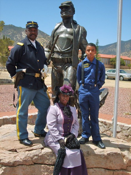 """Cmdr Fred Marable, DeVante London, Young Buffalo Soldier and Pvt. Michelle London-Marable, Lady of the Regiment, instead as a """"Buffalo Soldier"""" Cathy Williams, 1866 - 1868."""