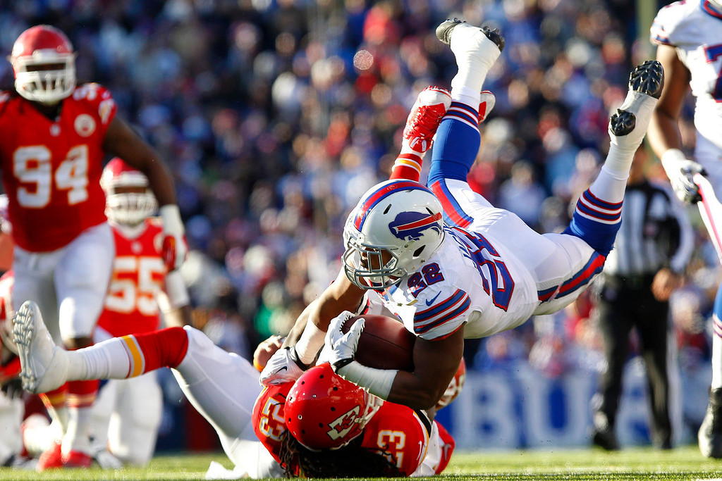 . Buffalo Bills running back Fred Jackson (22) is tackled by Kansas City Chiefs free safety Kendrick Lewis (23) during the third quarter of an NFL football game in Orchard Park, N.Y. Sunday, Nov. 3, 2013. (AP Photo/Bill Wippert)