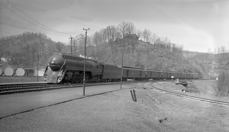 2018.15.N79.6189A--ed wilkommen 116 neg--N&W--steam locomotive 4-8-4 J 607 (streamlined) on passenger train--location unknown--no date