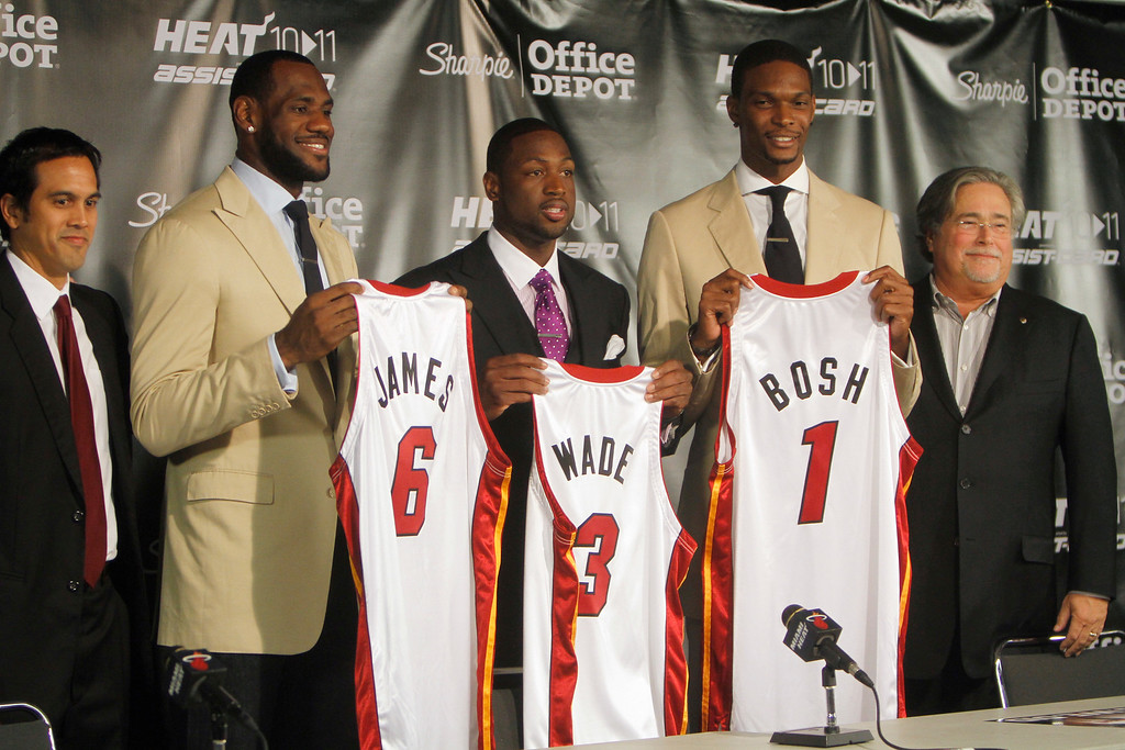 . From left, Miami Heat head coach Erik Spoelstra, LeBron James (6), Dwyane Wade (3), Chris Bosh (1) and owner Micky Arison attend a news conference at the American Airlines Arena in Miami on Friday, July 9, 2010. (AP Photo/J. Pat Carter)