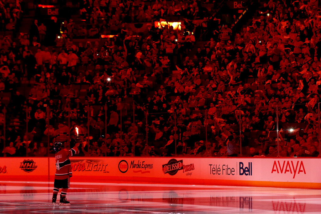 . MONTREAL, QC - MAY 17:  A young child in a Montreal Canadiens uniform carries a torch before the Canadiens take on the New York Rangers in Game One of the Eastern Conference Finals of the 2014 NHL Stanley Cup Playoffs at the Bell Centre on May 17, 2014 in Montreal, Canada.  (Photo by Bruce Bennett/Getty Images)