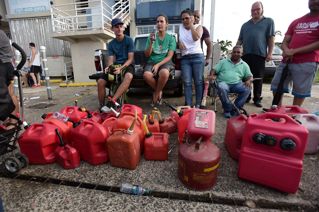 . Hundreds of people wait in line since the morning to buy gasoline three days after the impact of Hurricane Maria in Carolina, Puerto Rico, Saturday, Sept. 23, 2017. A humanitarian crisis grew Saturday in Puerto Rico as towns were left without fresh water, fuel, power or phone service following Hurricane Maria�s devastating passage across the island. (AP Photo/Carlos Giusti)
