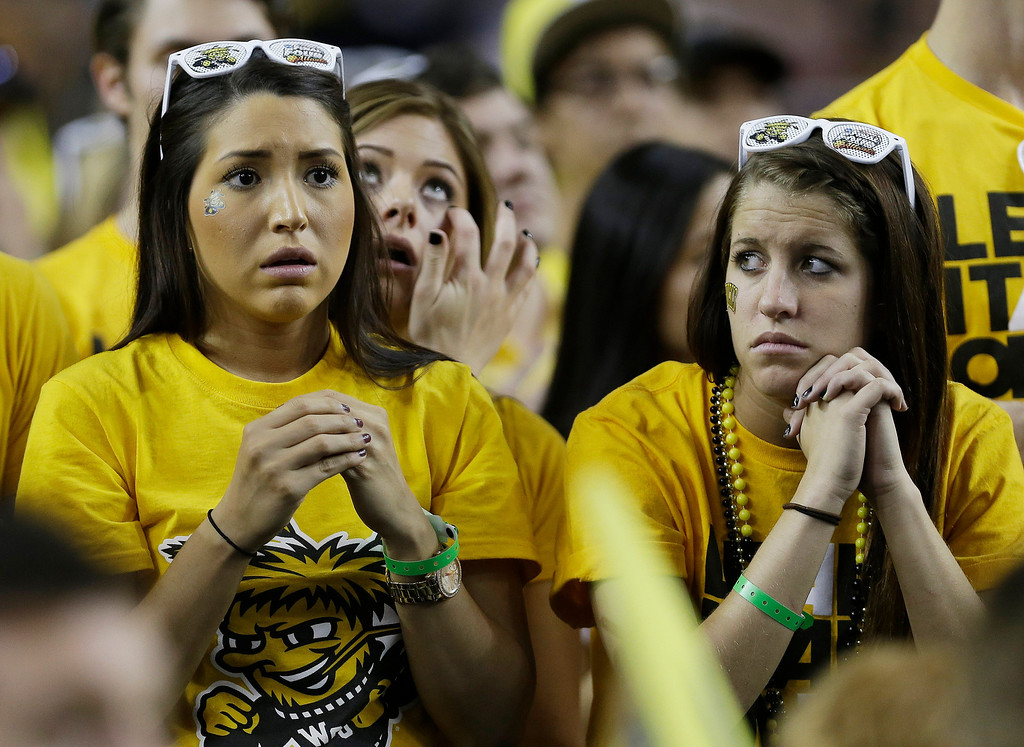 . Wichita State fans watch play against Louisville during the second half of the NCAA Final Four tournament college basketball semifinal game Saturday, April 6, 2013, in Atlanta. (AP Photo/Charlie Neibergall)