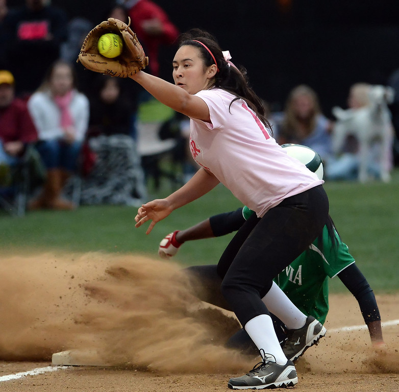. Monrovia\'s Elise McCarthy steals third base ahead of the tag by La Canada third baseman Sammy Jedrey in the first inning of a prep softball game at La Canada High School in La Canada, Calif., on Friday, April 25, 2014.  (Keith Birmingham Pasadena Star-News)