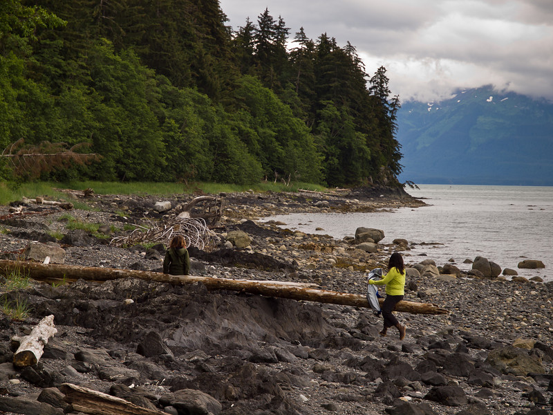 Taking in the view. There were a number of old logs set uup as see-saws on this beach. North Douglas.