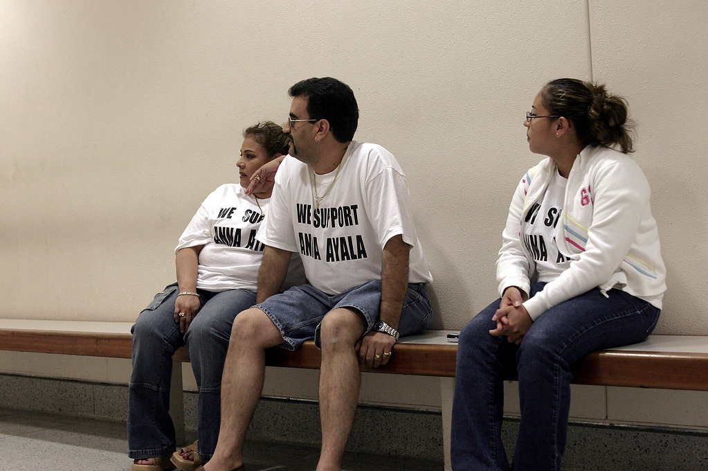 ". Anna Ayala\'s family members (names were not given) wait outside the  courtroom for Ayala\'s arraignment at the Santa Clara County Superior Court in  San Jose on May 9, 2005. About a dozen family and friends came to the  courthouse to show their support for Ayala, all wearing a t-shirt that said,  "" We Support Anna Ayala\"" in the front and \""Innocent\"" in the back. (Joanne Ho-Young Lee/San Jose  Mercury News)"