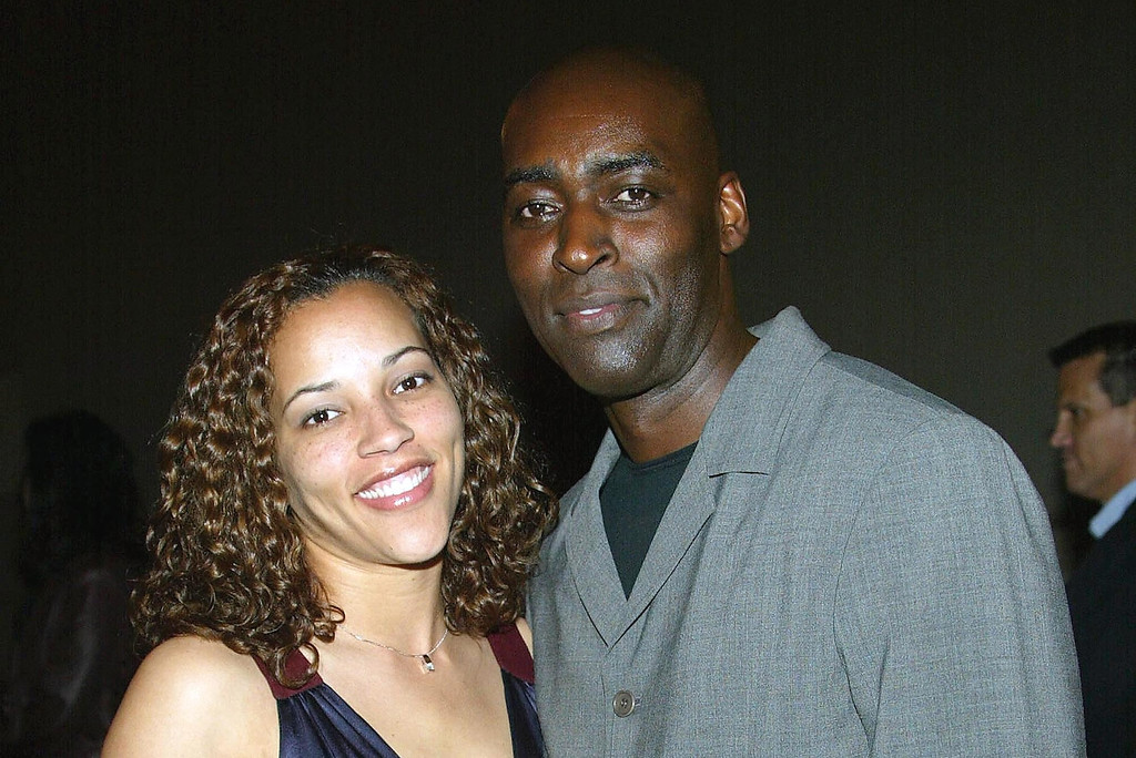 ". File - Actor Michael Jace (R) and  April attend the third season premiere screening of ""The Shield\"" at the Zanuck Theater on March 8, 2004 in Los Angeles, California.  Michael Jace is accused of killing his wife April in 2014. An expert helped the LAPD hack into her locked iPhone. (Photo by Frederick M. Brown/Getty Images)"